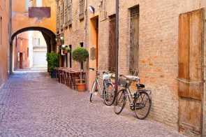 20141015171733230800_shutterstock_121762441_old small stone medieval street in historical center of Ferrara, Italy